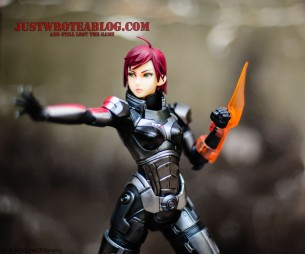 Fem Shepard with energy sword attachment.