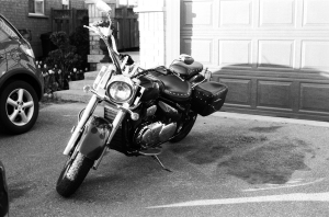 Motorcycle parked in my neighbour's driveway