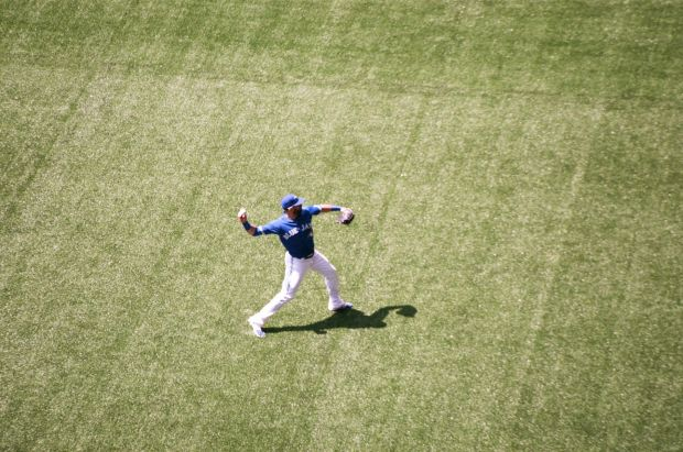 Jose Bautista throwing the ball between innings.