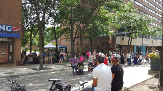 Enjoying the music at McGill-Granby Parkette.