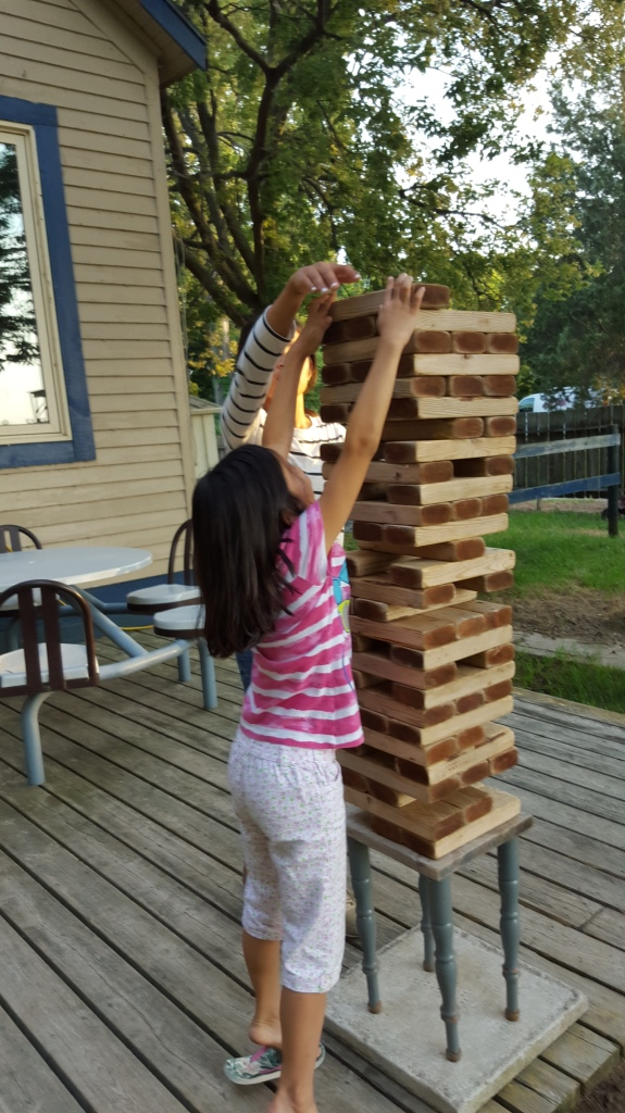 The JENGA! tower got taller than one kid...