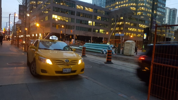 Yellow Cab on a sidewalk... (Wellington St. west of Bay St., Toronto)